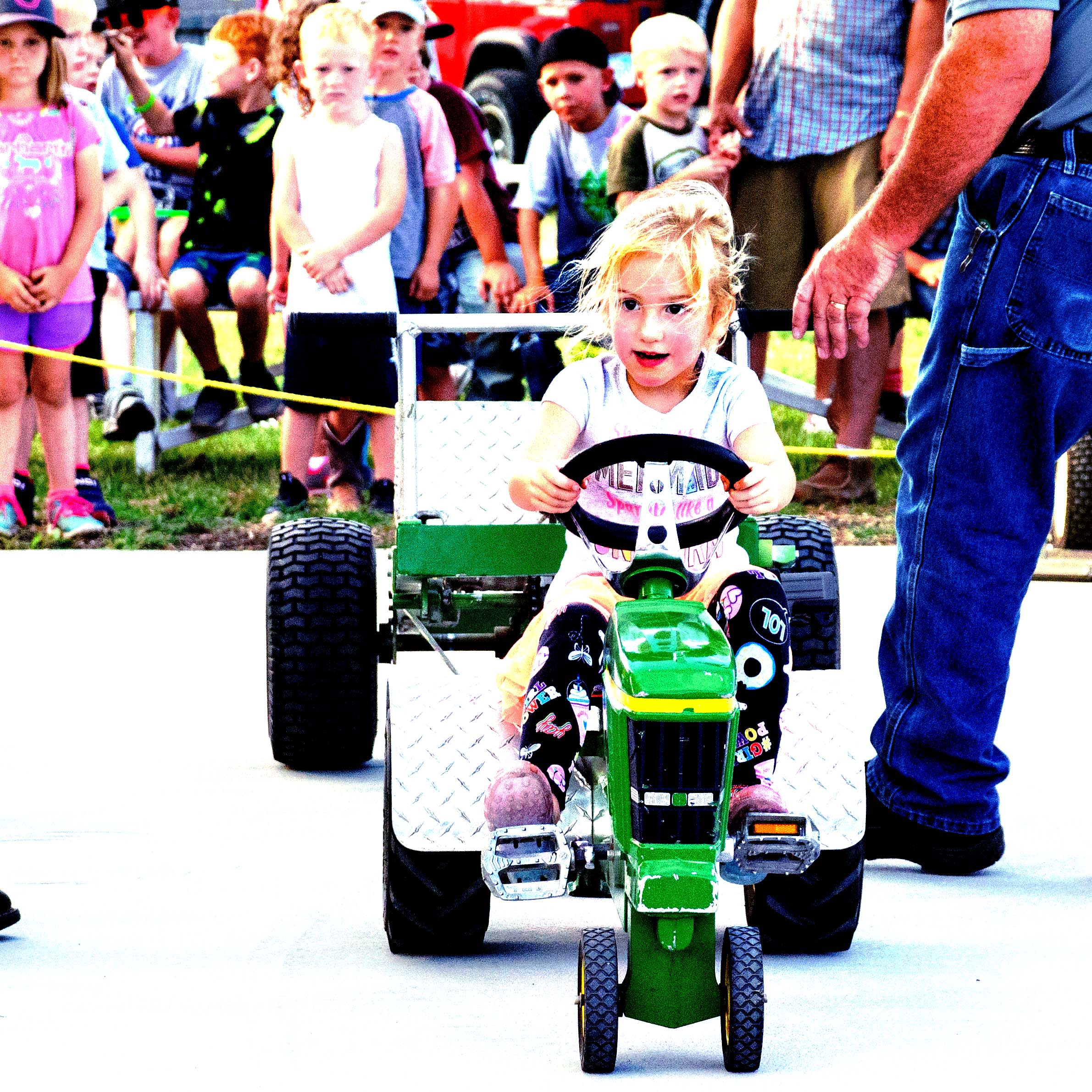 Hillsboro graduates await walking down the track toward their seats during Hillsboro High School commencement Saturday afternoon. From left, Tassanee Sanchez, Matthew Denholm, Aaron Shaffer, Austin Cross, and Mosharay Smith-Graves. 29 students graduated at the Joel Wiens Stadium, with Reece Berens, Matthew Denholm, Lydia Kliewer, and Kalen Moss serving as valedictorians.