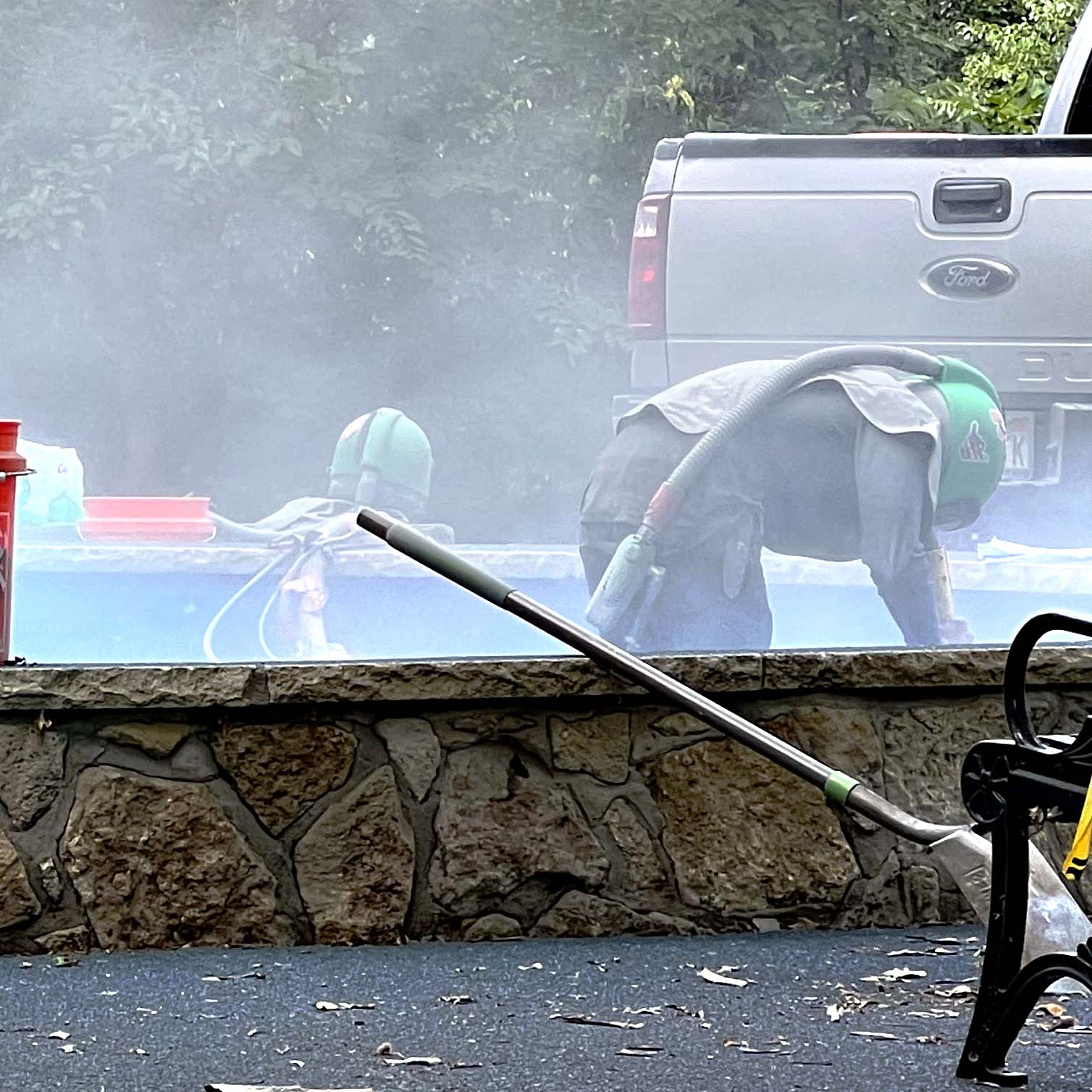 Evan Just, left, and Kathy Richter, center, hold sale items as Roger Hiebert, right, conducts an auction Saturday at Aulne United Methodist Church. The auction raised more than $10,000 for charity.