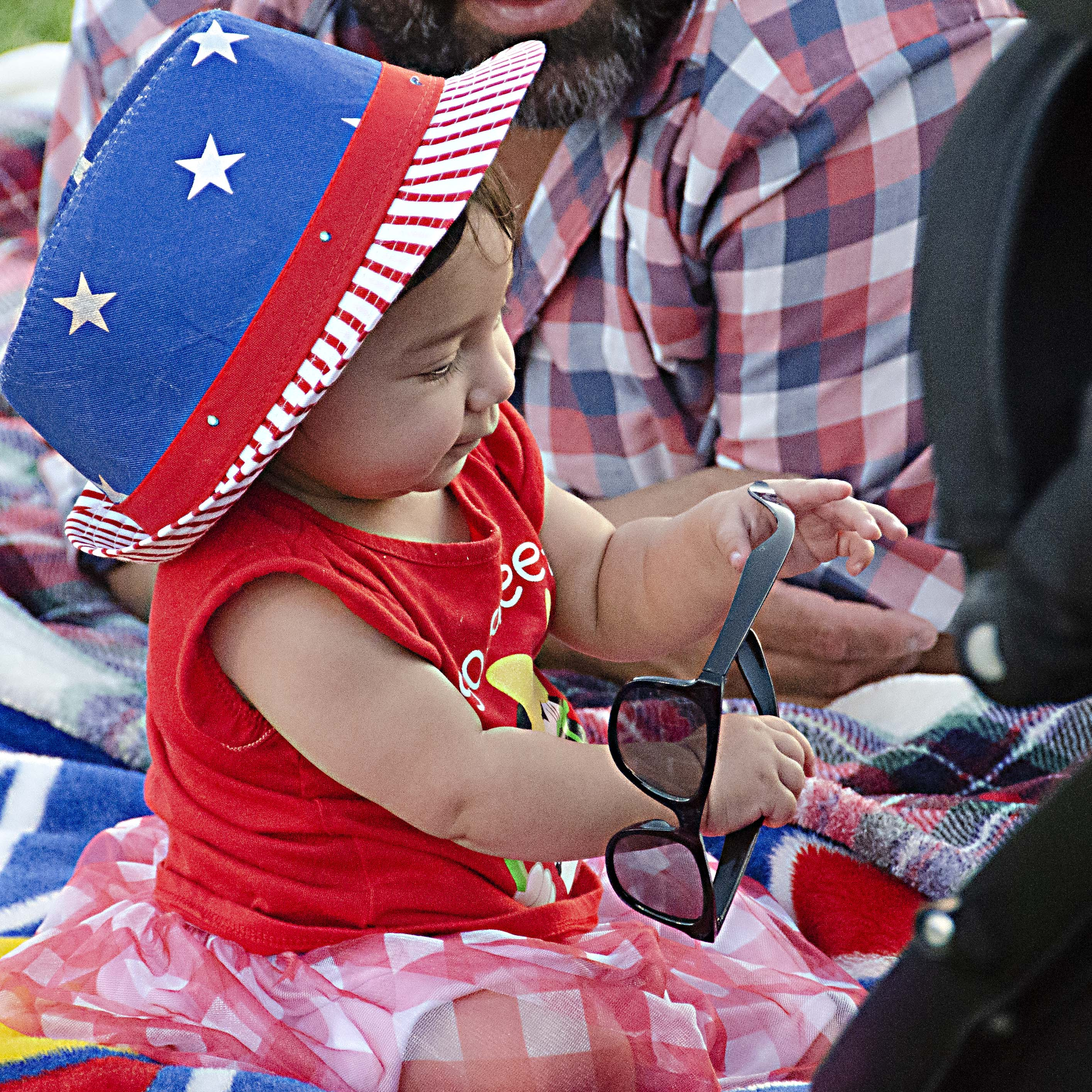 Members and helpers of the Ebenfeld Mennonite Brethren Church youth group take orders for bags of kettle corn at the Arts and Crafts fair. Hillsboro police chief Dan Kinning said between 35,000 and 40,000 were estimated to have attended the fair.