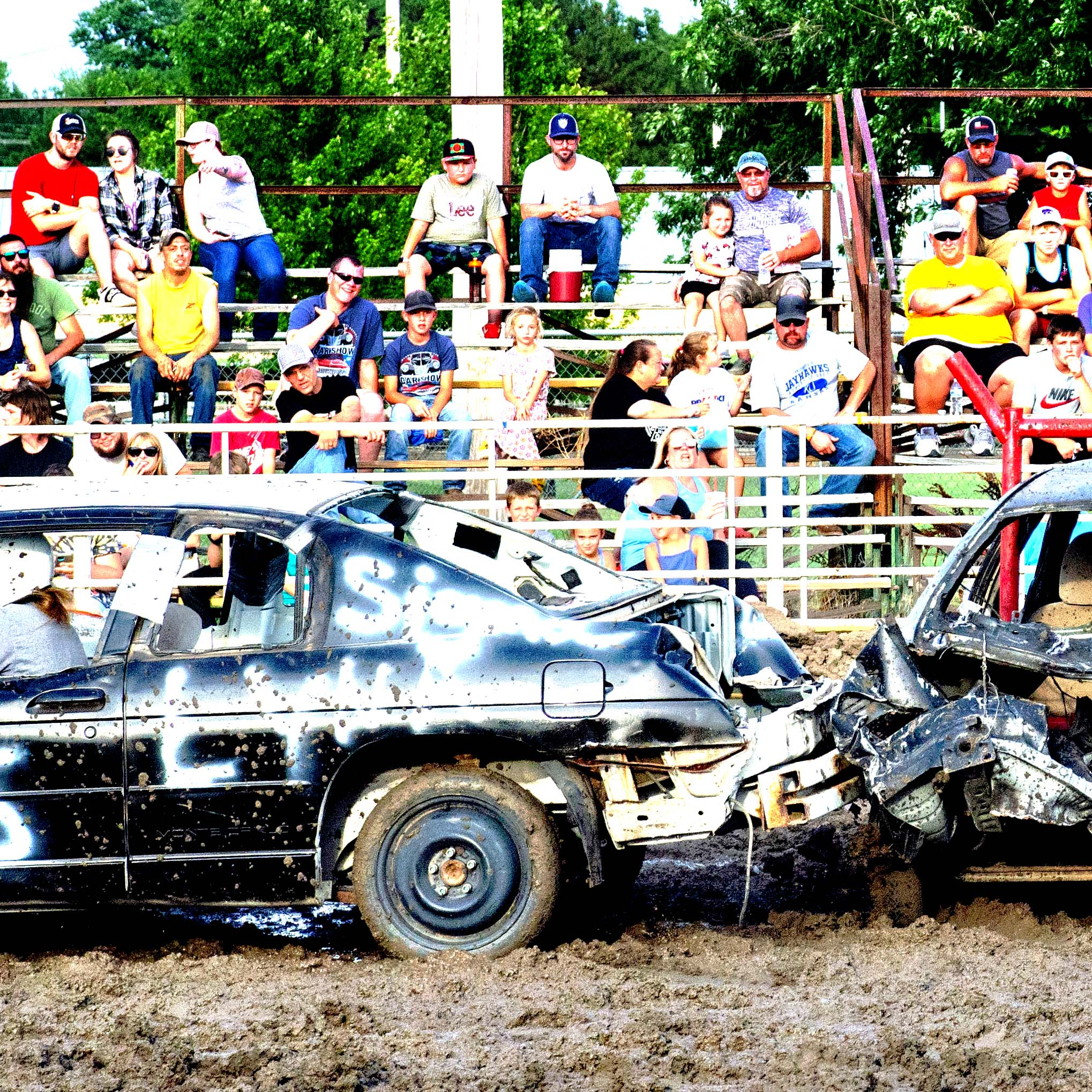 Emily Jost, left, and Alex Ratzlaff jump to block the shot of a McPherson player Saturday, while Tara Proffitt positions herself to respond should the ball get through. The Trojans beat McPherson to advance to the championship match, where they lost to Bishop Carroll.